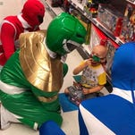 Boy battling cancer gets shopping trip, visit with the Power Rangers