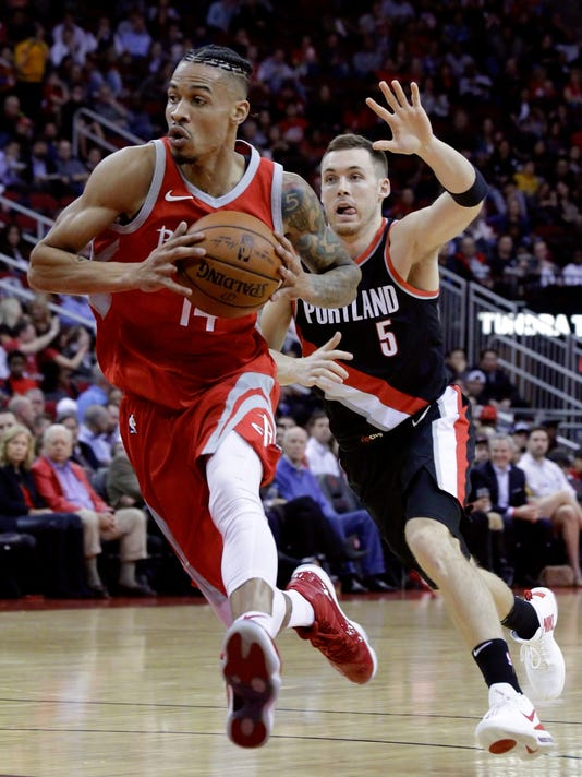 Houston Rockets guard Gerald Green (14) drives past Portland Trail Blazers guard Pat Connaughton (5) during the first half of an NBA basketball game Wednesday, Jan. 10, 2018, in Houston. (AP Photo/Michael Wyke)