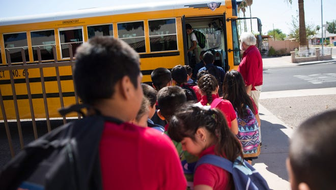 Students from C.O. Greenfield Elementary School board a Roosevelt Elementary School District bus after school in Phoenix. The Republic found that the Roosevelt district had the highest school bus inspection failure rate — 73 percent — of any district in Maricopa County during the 2013-2015 period.