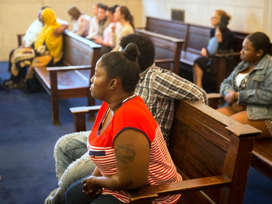 Malyyka Bonner, right, listens during a competency
