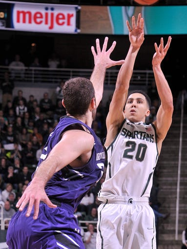 Spartan Travis Trice puts in a shot from the top of