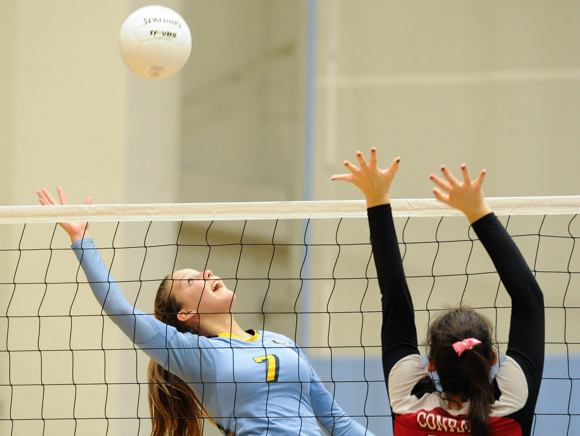 Cape's #7 Logan Shuttleworth with a spike in the second game against Conrad Thursday night at Cape Henlopen High School.