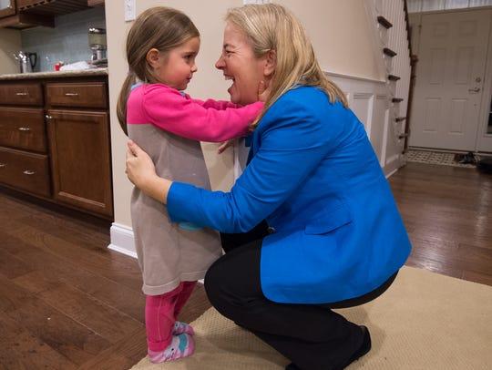 Marybeth Edgar hugs her daughter, Sophie, 4, before