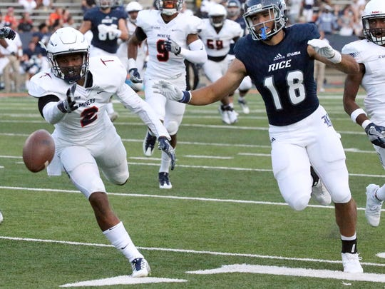 Rice Owls wide receiver Kylen Granson, 18, cannot catch an overthrown pass Saturday against UTEP in the Sun Bowl Stadium in El Paso, TX. At left is UTEP defensive back Michael Lewis, 2.