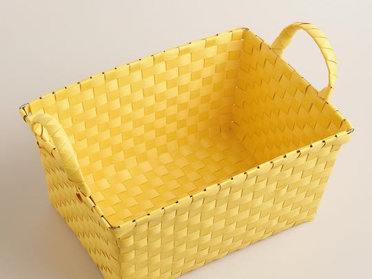 Corral all your shampoos, hair treatments and skin scrapers into one neat little shower caddy. In cornsilk yellow, perch it on the edge of the tub and keep his stuff from touching yours. $6.99, World Market.