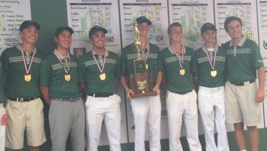 McNicholas' golfers and coach Justin Lenczicki take home the Division II boys state championship title.
