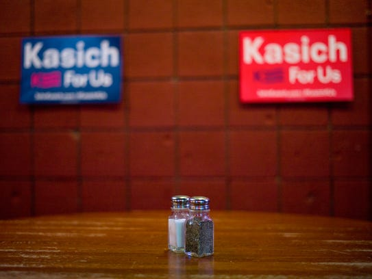 Campaign signs for John Kasich are seen at a campaign