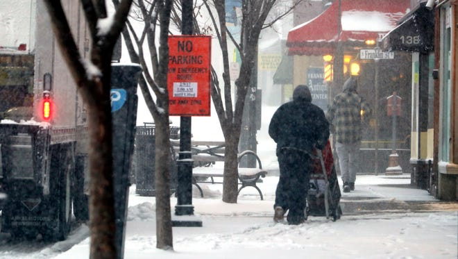 A worker makes an early morning delivery to a deli on Main St. in Nyack through heavy snow Feb. 9, 2017.