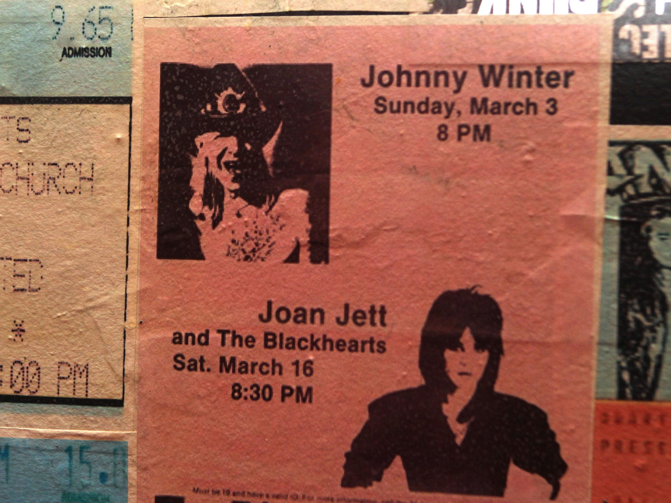 Enlarged copies of tickets from bands that have played
