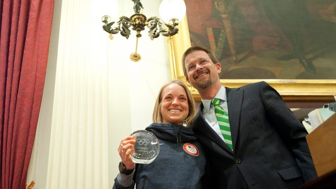 Liz Stephen poses alongside Vermont Speaker of the House Shap Smith as Vermont members of the 2014 U.S. Winter Olympic team were honored at the Statehouse on Wednesday.