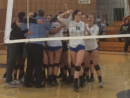 MC volleyball celebrates