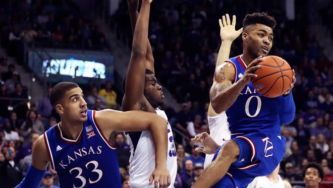 Frank Mason III looks to pass during the second half.