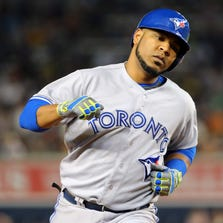 Toronto Blue Jays first baseman Edwin Encarnacion (10) rounds the bases on his two run home run during the eighth inning against the New York Yankees at Yankee Stadium. New York Yankees won 6-4.
