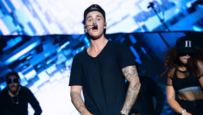 Recording artist Justin Bieber performs at the 2015 Billboard Hot 100 Music Festival at Nikon at Jones Beach Theater on Sunday, Aug. 23, 2015, in Wantagh, N.Y. (Photo by Scott Roth/Invision/AP)