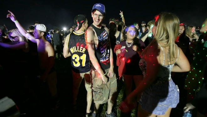 Party-goers at an electronic dance music party boogie at the IMS Coke Lot, which hosts revelers in the days leading up to the Indianapolis 500. This party on Friday, May 22, 2015, was broken up by law enforcement before 11 p.m., citing the size of the crowd gathered. There also was a 1 a.m. get-to-your-campsite curfew in effect.