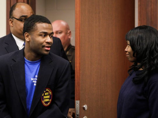 Charles Lewis Jr., 18, smiles at his mother Trisha Lindsey as he enters Judge George Economy's courtroom Tuesday, to determine the next steps in the sentence related to his murder conviction in juvenile court for the killing of 19-year-old Shayla Johnson in 2010. Behind Lewis is his W.J. Maxey Boys Training School Treatment Leader Tommie Chaney, who tesitfied during the hearing.