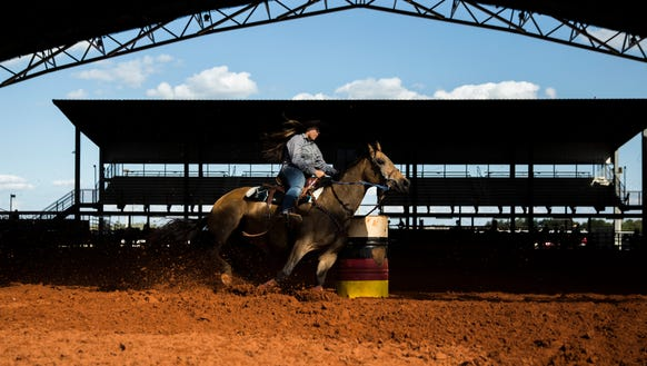 Budha Jumper competes in 13-17 year old barrel racing