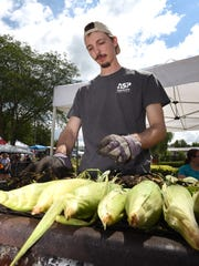 Luke Olarvi and other members of Milford's United Methodist Church grilled up some corn in the husk for Milford Memories last year. They'll be back at this festival.