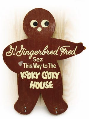 An original sign points the way to a replica of the old Kooky Cooky House that used to open every Christmas from the 1960s through the mid-1980s at the now demolished Capitol Court mall.