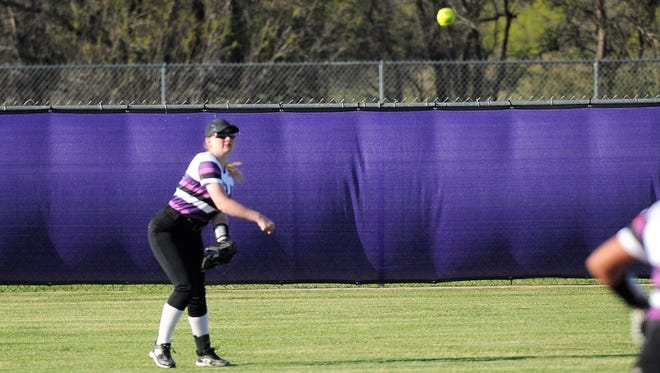 Wylie left fielder Kaylin Samulde (14) throws the ball to the cutoff to get an out at second base during the seventh inning of the Lady Bulldogs' 3-1 win against Big Spring on Tuesday, April 3, 2018.