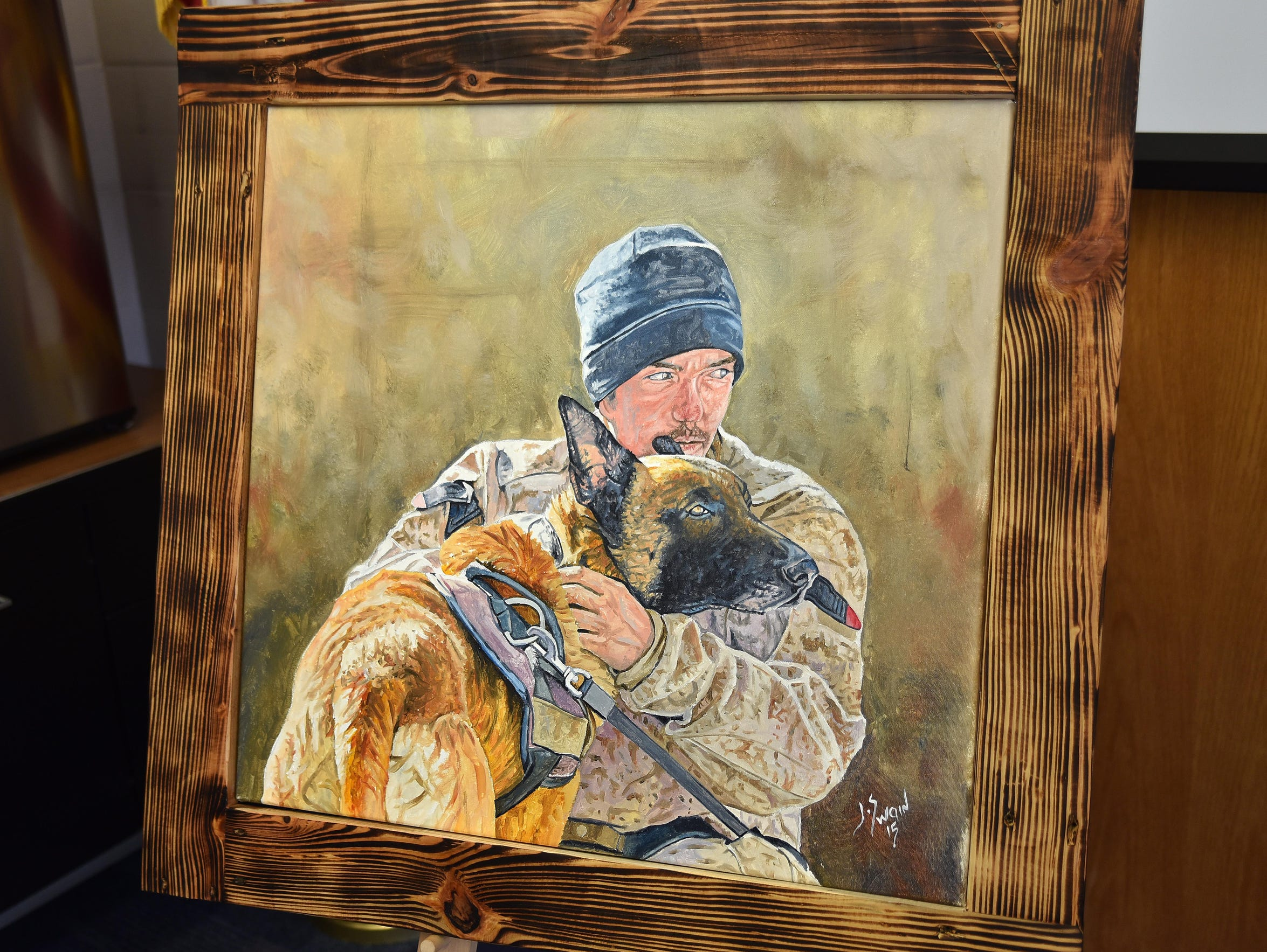 The portrait of Marine Cpl. Derrick Magee and his K9