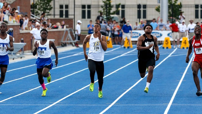 Boyle CountyÕs Landen Bartleson, center, wins the Class 2-A track and field Boys 100 Meter Dash
