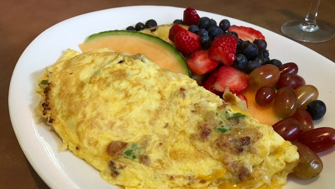 The House Omelet from House of Omelets features four eggs, sausage, bacon, onions, mushrooms, ham and peppers.