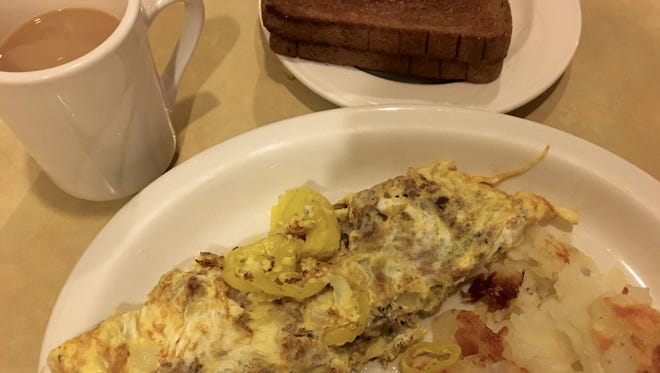 A Philly cheese steak omelet with potatoes and wheat toast from Old 41 Restaurant in Bonita Springs.