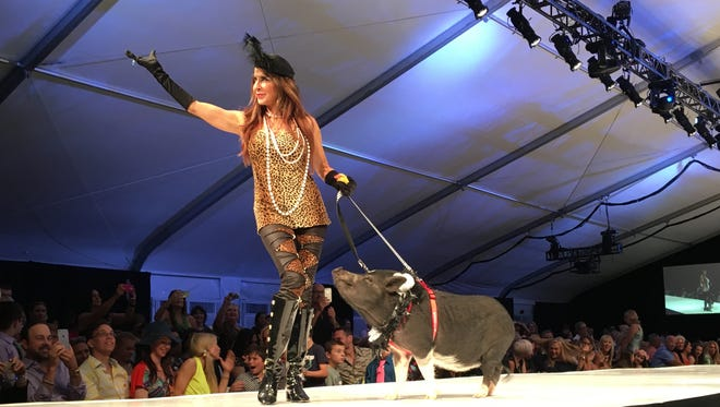 A pig took center stage Saturday night at the annual La Chien fashion show to benefit the Humane Society of the Desert at El Paseo Fashion Week.