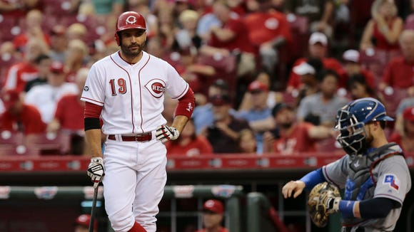 Reds first baseman Joey Votto stands by between pitches during an at-bat Wednesday against the Rangers.