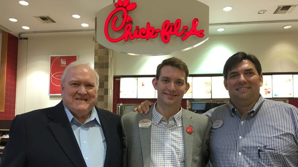 Original Montgomery Chick-fil-A franchisee Jeff Vines, left, and his grandson Jason Soriano center, and Gary Soriano celebrate a re-launch of the Eastdale Mall spot on Friday.
