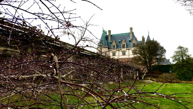 An image of Biltmore House, as seen from the path to the gardens.