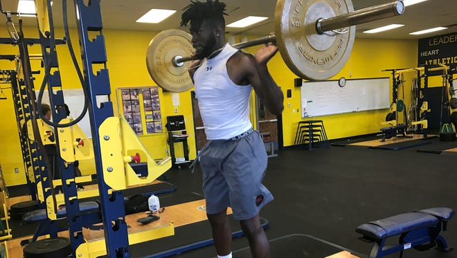 Island Coast graduate Jordan Diggs lifts weights during a workout Thursday at Lehigh Senior High. Diggs, a University of South Carolina graduate, will work out for NFL Scouts Tuesday at USC's pro day.