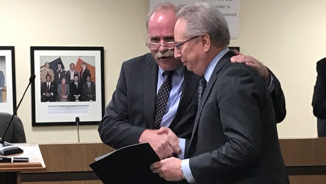 At-Large Councilman Rich  McMahon, left, presents Hillside School teacher Louis D'Amico with a proclamation from the council on Tuesday, March 28.