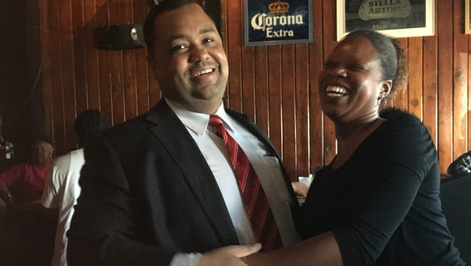Mayoral candidate Coleman Young II hugs a supporter at a campaign event held at the Thomas Magee's Sporting House & Whiskey Bar in Eastern Market, Monday, May 16, 2017.