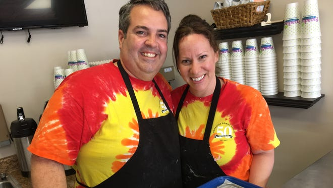 Travis and Shauna Roth, owners of Paradise Donuts in Staunton, celebrate a soft opening on Tuesday, May 16, 2017 at their Central Avenue store.