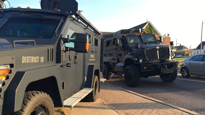 SWAT vehicles park outside Master Kutts barber shop at 500 East Main Street on Friday, June 2.
