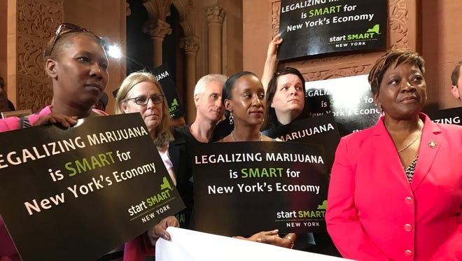 Assemblywoman Crystal Peoples-Stokes, right, stands with advocates who want to legalize recreational marijuana during a news conference at the Capitol on Monday, June 12, 2017.