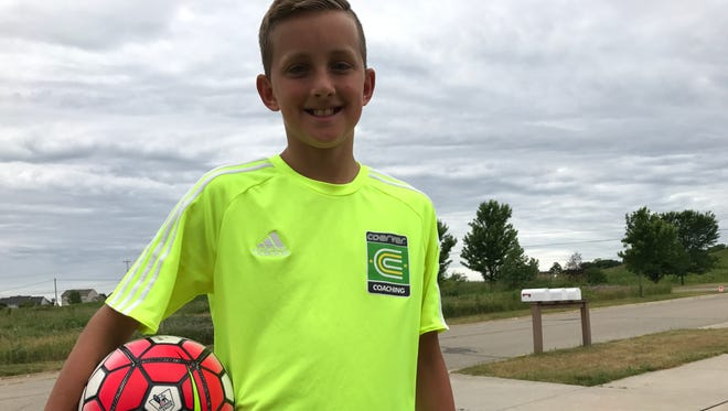 DeWitt soccer player Dylan Bott, 11, has collected aluminum cans, had pizza and euchre fundraisers and sold lemonade since January to pay for a trip to Sweden for the Youth World Cup of soccer.