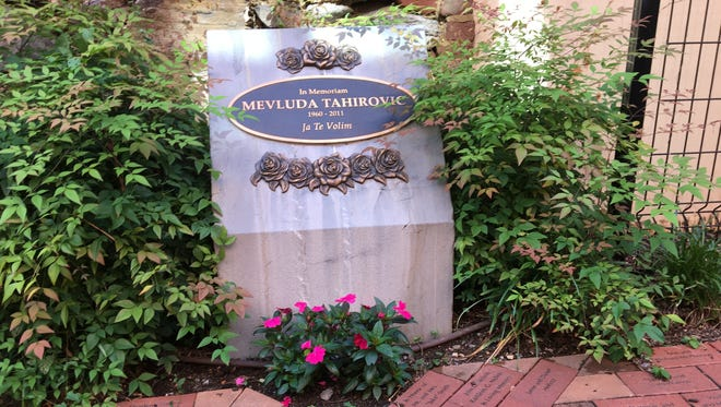 "The Smith Center's Mevluda Tahirovic Memorial Garden in Staunton. Tahirovic's name is inscribed in a plaque surrounded by roses, her favorite flower, and ""Ja Te Volim"" – I love you."