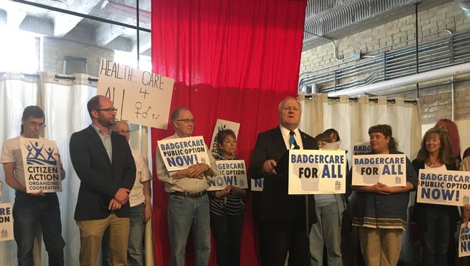 State Rep. Eric Genrich, at left with arms crossed, and state Sen. Dave Hansen co-sponsored a bill that would open BadgerCare to all state residents as an alternative to private insurance.