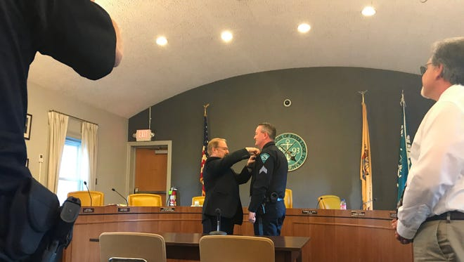 River Edge Police Chief Tom Carriddi presented Michael McGinty with a new badge on June 20, 2017. Moments before, McGinty had been sworn into his new role as sergeant in the River Edge Police Department.