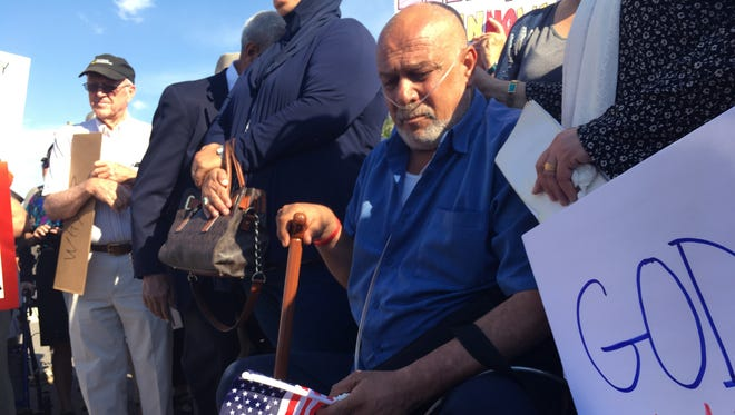 Kadhim Al-bumohammed, center, a 64-year-old Iraqi refugee in the U.S., listens to speakers at an Albuquerque rally in his honor on Monday, June 26, 2017. Around 300 supporters demonstrated outside the Immigration and Customs Enforcement offices in Albuquerque, N.M., in support of Al-bumohammed who may face deportation. Supporters say Al-bumohammed helped train U.S. soldiers going to Iraq and will face death if he's deported.