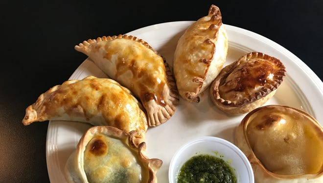 Pilar's Empanadas come in a variety of flavors incuding, from left: spinach, chicken, beef, corn, blue cheese, and onion with cheese.
