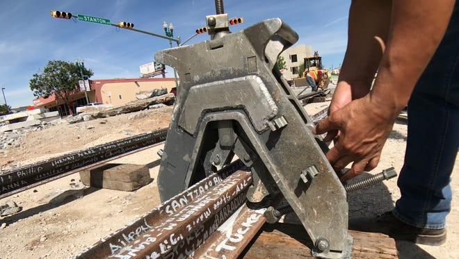 Curtis Boggess, a welder for Paso del Norte Trackworks, in August 2017 rechecks the alignment of the last portion of rail and prepares it for the 404th thermite weld, which signaled the completion and end of the rail work phase for the El Paso Streetcar Project.