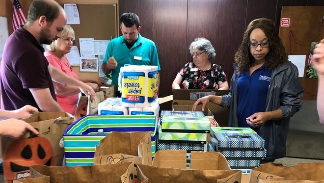 AngelWish volunteers bag up gifts of practical items for senior citizens in Union County.
