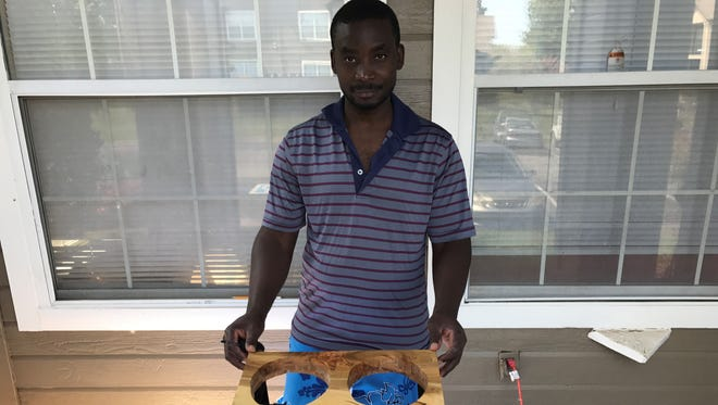 Fidele Ntuyenabo, a refugee from Uganda and Democratic Republic of Congo, lives in Middle Tennessee and is a woodworker at LenoxRose social enterprise.