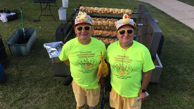 Scott (left) and Steve Lovas officiated the annual Chicken Fling contest.