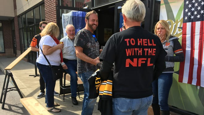 Ed Baer, of Florence, brought Steelers jerseys and a terrible towel to burn. Baer said after 20 years as a fan, he is done with the NFL after national anthem protests.