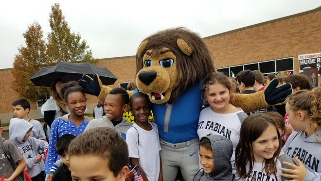 Detroit Lions mascot Roary joined the students at St. Fabian on their Oct. 6 diversity walk.